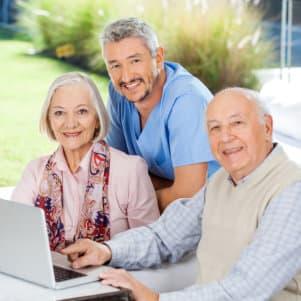 senior couple with caregiver