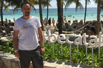 man with beach on the background